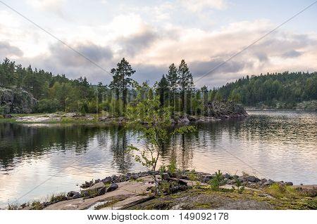 Calm summer evening at Ladoga lake islands in Karelia republic.