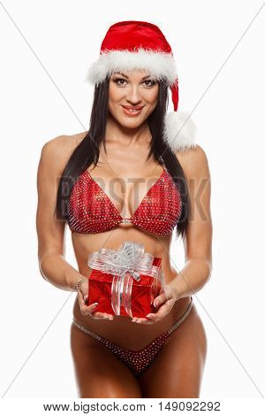 beautiful sexy girl wearing santa claus clothes with christmas gift.