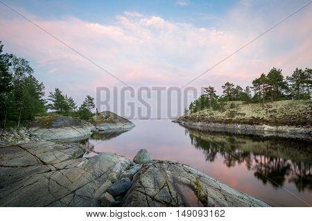 Evening landscape of scenic Karelia republic nature. Small bay at Ladoga lake island.