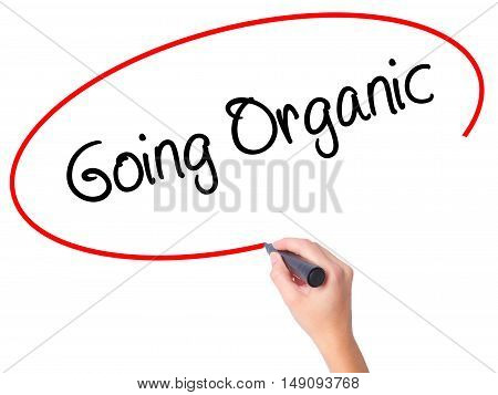 Women Hand Writing Going Organic With Black Marker On Visual Screen
