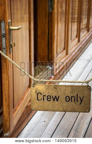 Sign with inscription Crew only on the ship