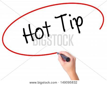 Women Hand Writing Hot Tip With Black Marker On Visual Screen.