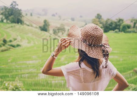 Woman traveler looking at green rice terraces field in Chiangmai Thailand Vintage tone