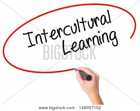 Women Hand Writing Intercultural Learning With Black Marker On Visual Screen