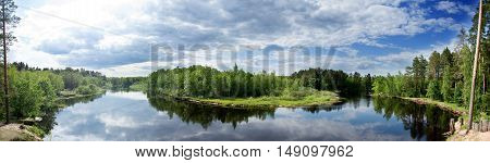 Panorama of a river flowing through a forest. Brikin bor. Russia