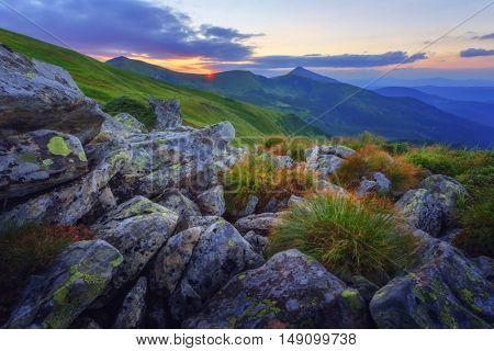 View of the stony hills glowing by evening sunlight. Dramatic autumn scene. Chornohora ridge, Carpathians, Ukraine, Europe.