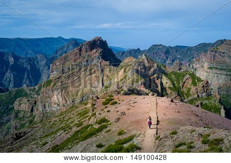 Group of tourists is walking back from Pico Ruivo hiking route number one at Madeira island.