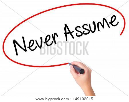 Women Hand Writing Never Assume With Black Marker On Visual Screen.