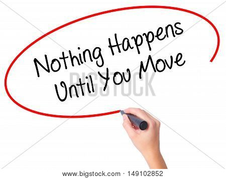 Women Hand Writing Nothing Happens Until You Move With Black Marker On Visual Screen