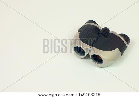 Binocular. Use binoculars to look for a clear visual range.
