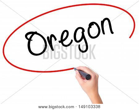 Women Hand Writing Oregon With Black Marker On Visual Screen