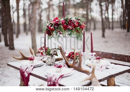Wedding Table Setting In Marsala Colors With Plates, Cutlery, Red Floral Compositions, Candles, Velv