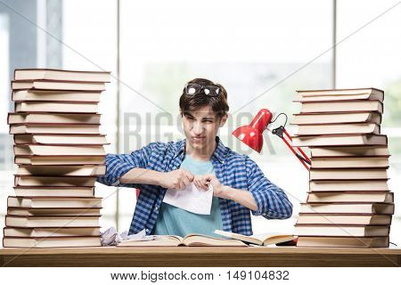 Young man student preparing for college exams