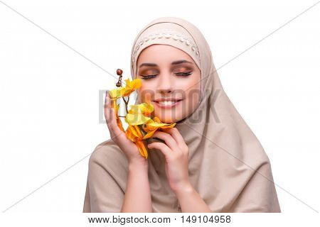 Arabian woman with orchid flower isolated on white
