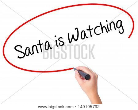 Women Hand Writing Santa Is Watching With Black Marker On Visual Screen