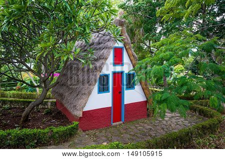 Traditional style farmer house at Funchal botanical garden. Madeira island, Portugal.