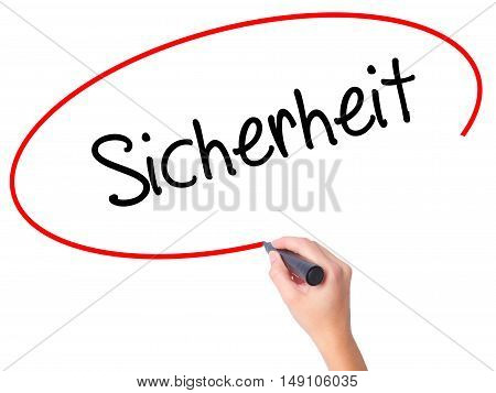 Women Hand Writing Sicherheit (safety In German) With Black Marker On Visual Screen