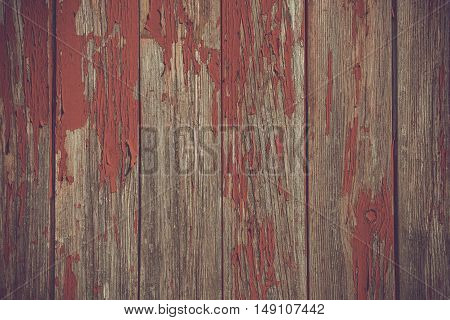 Red Paint Pealing Off Wooden Planks