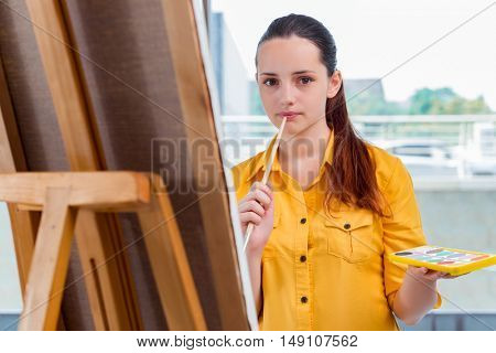Young student artist drawing pictures in studio
