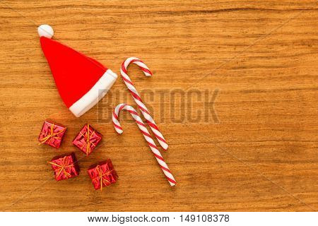 Christmas candy canes, gifts, and on a wooden background