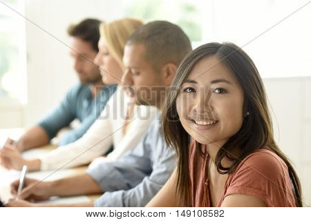 Beautiful ethnic woman attending business meeting