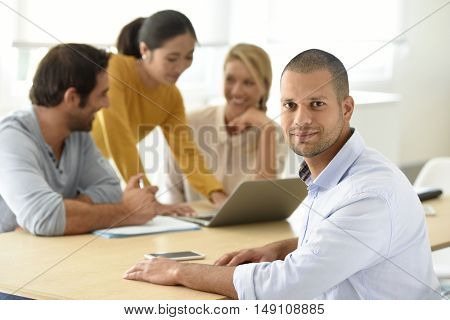 Portrait of man attending work meeting