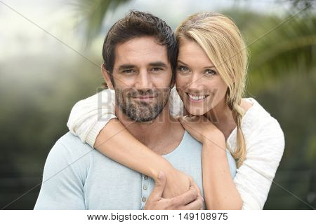 Attractive couple embracing each other