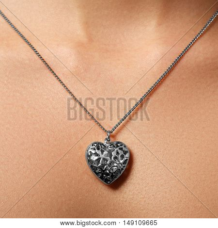 Golden Heart Pendant. Beauty And Jewelry Concept. Woman Wearing
