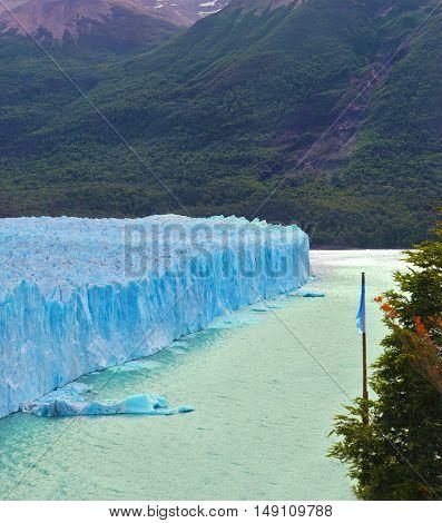 Los Glaciares National Park in Argentina. Colossal Perito Moreno glacier in Lake Argentino. Sunny and windy summer day