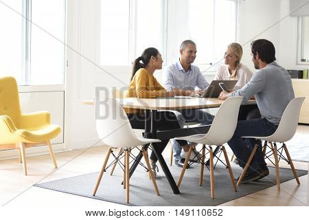 Business people meeting around table in office