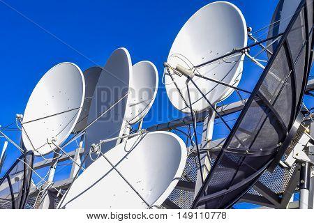 Satellite dish on blue sky background .