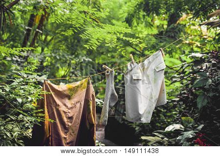 Dirty laundry on a wire in a jungle