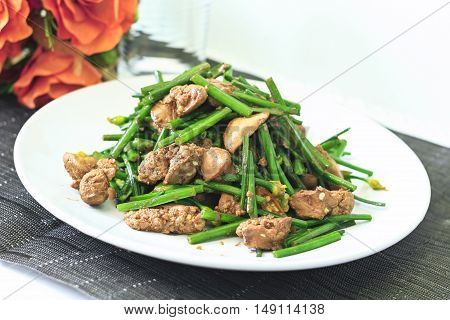 Fried garlic chives with chicken livers on white