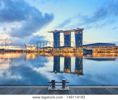 Singapore, Republic of Singapore - May 4, 2016: Marina Bay Sands hotel, ArtScience museum and Flyer observation wheel glowing at sunrise
