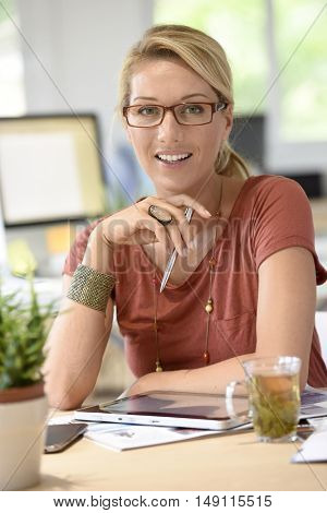 Attractive woman designer working from home-office