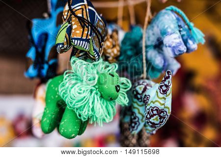 colorful sewn fabric toys at african souvenir market