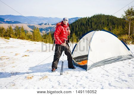 A Tourist Stands Near The Tent.