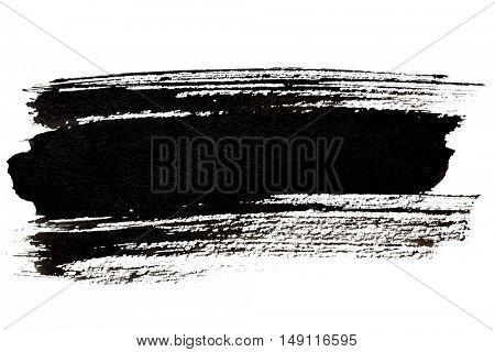 Black brush stroke closeup isolated over the white background