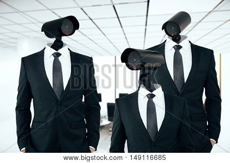 Three businessmen in suits with CCTV camera instead of heads on interior background. Business/organization security management concept