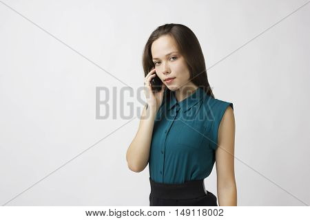 beautiful young woman calling by phone business contract