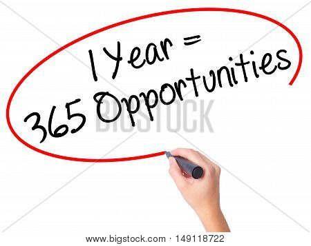 Women Hand Writing 1 Year = 365 Opportunities With Black Marker On Visual Screen