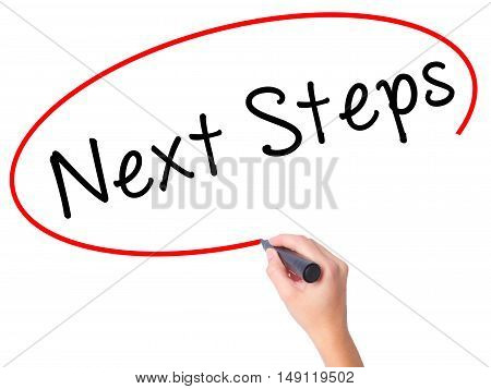 Women Hand Writing Next Steps With Black Marker On Visual Screen