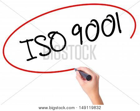 Women Hand Writing  Iso 9001 With Black Marker On Visual Screen