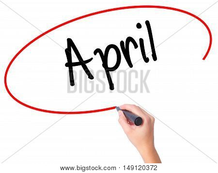 Women Hand Writing  April  With Black Marker On Visual Screen