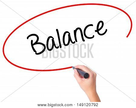 Women Hand Writing Balance With Black Marker On Visual Screen
