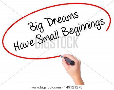 Women Hand Writing Big Dreams Have Small Beginnings With Black Marker On Visual Screen