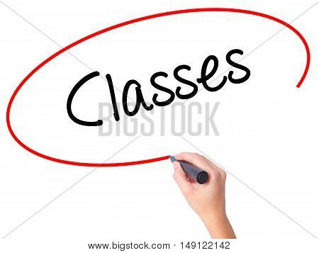 Women Hand Writing Classes   With Black Marker On Visual Screen
