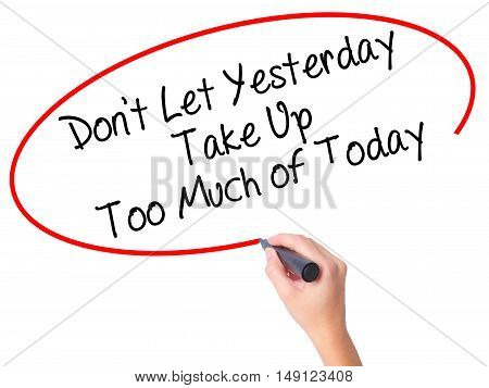 Women Hand Writing Don't Let Yesterday Take Up Too Much Of Today With Black Marker On Visual Screen.