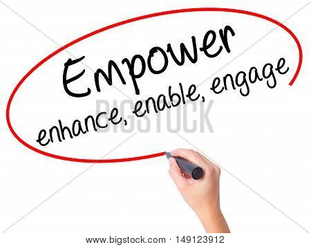 Women Hand Writing Empower Enhance, Enable, Engage With Black Marker On Visual Screen