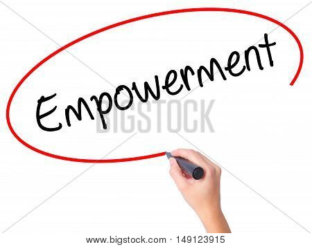 Women Hand Writing Empowerment With Black Marker On Visual Screen.